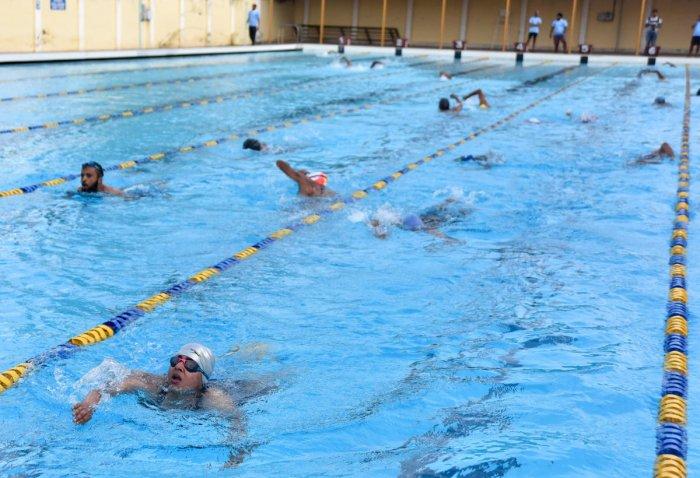 Triathletes in action during Dasara Triathlon at the University swimming pool in Mysuru on Sunday.