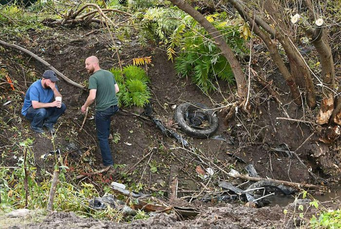 Distraught family members take in the scene October 7, 2018 in Schoharie, New York, one day after an accident in Schoharie, New York, that left 20 people dead. - Twenty people were killed in a limousine crash in New York state, police confirmed, with loca