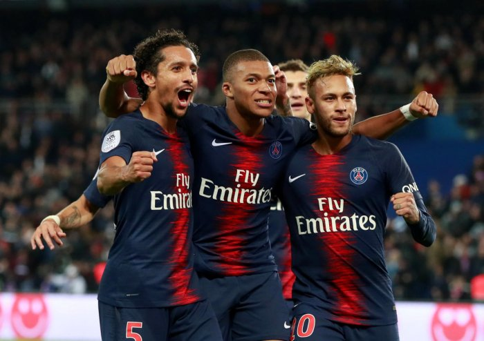 Paris St Germain's Kylian Mbappe celebrates scoring their fifth goal with teammates. (REUTERS)