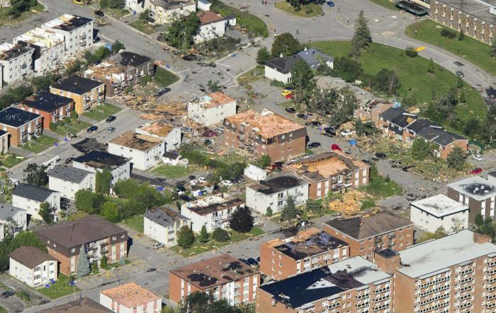 Damage from a tornado is seen in Gatineau, Quebec, Canada on Saturday, Sept. 22, 2018. The storm tore roofs off of homes, overturned cars and felled power lines. (AP/ PTI File Photo)