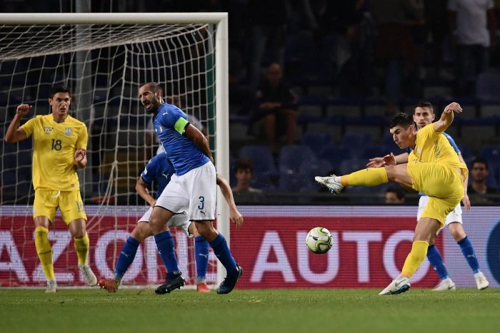 PERFECT FINISH: Ukraine's Ruslan Malinovskyi (right) shoots to score an equaliser during a friendly against Italy on Wednesday. AFP