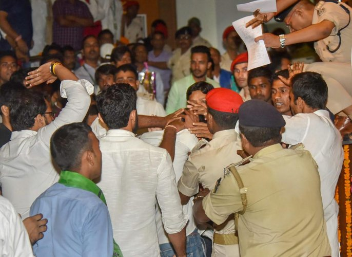 Police detain an unidentified man who threw a slippers at Bihar Chief Minister Nitish Kumar during 'Virat Chhatra Sanagam', in Patna, Thursday, Oct 11, 2018. (PTI Photo)