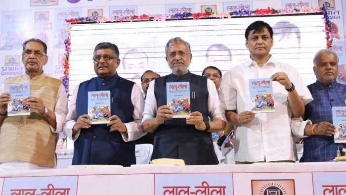 The book was released at a programme in Patna on Thursday. (Image: Twitter/@SushilModi)