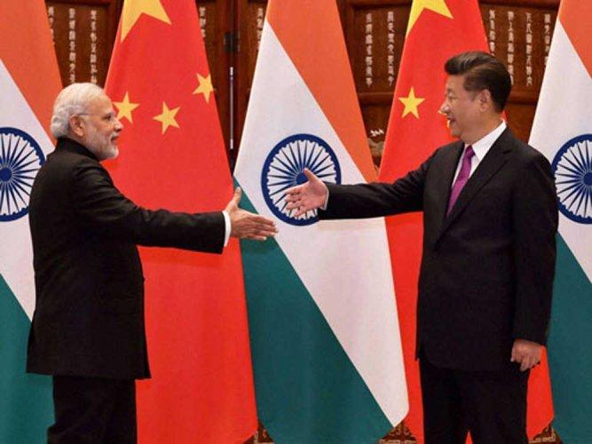 Narenda Modi and Xi Jinping. PTI photo.