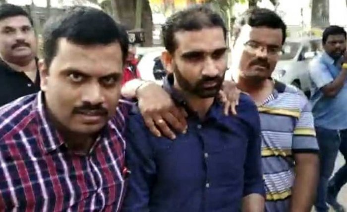 Saleem (centre) being picked up by the CCB. Screengrab.
