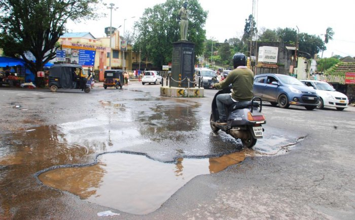 A huge pothole in front of Madikeri CMC.