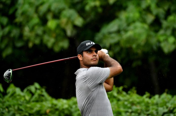 STEADY GOING: Shubhankar Sharma watches his tee shot during the opening round of the CIMB Classic on Thursday. AFP