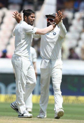 Umesh Yadav celebrates with Virat Kohli after dismissing Shai Hope. AFP