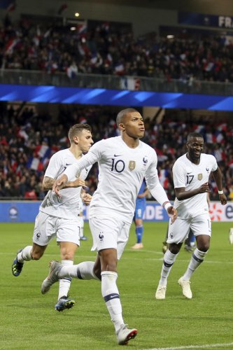 SUPER SUB: France's Kylian Mbappe (centre) celebrates after scoring against Iceland in a friendly on Thursday. AP/PTI