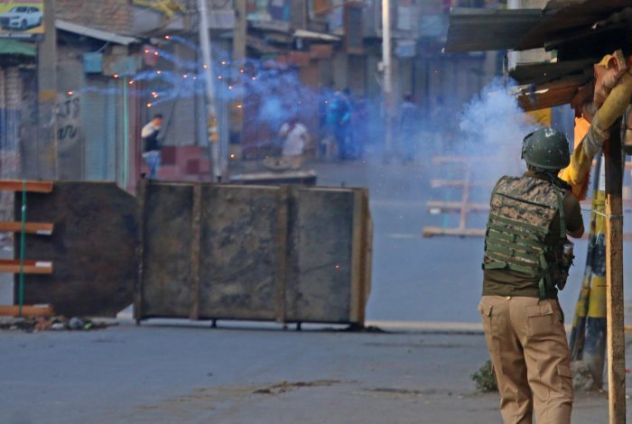 Clashes between protesters and forces in Anchar area of Soura in Srinagar on Friday. Umer Asif