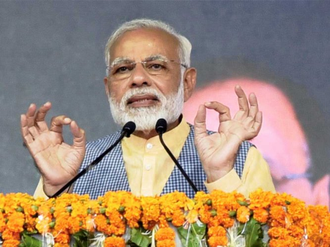 """Several leaders who are called stalwarts of the Congress and former ministers are out on bail these days,"" Modi said at a public rally in Jaipur, punning on the Hindi term for a bullock cart. (PTI File Photo)"