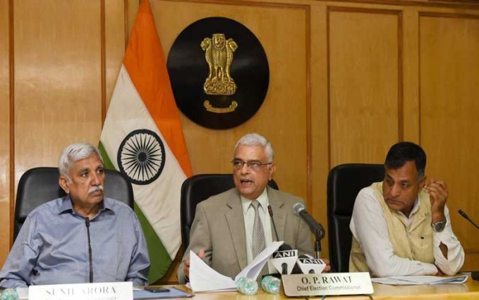 Chief Election Commissioner O P Rawat formally handed over the EPICs in braille to two visually challengedelectors at the end of the conference, which the EC held in New Delhi for discussion on ways to make elections accessible for the people with disabilities. (PTI Photo)