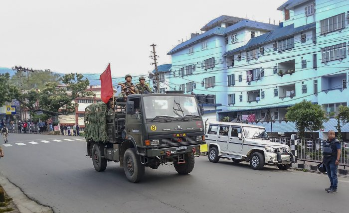 Army personnel patrol a street during curfew after clashes between the residents of the city's Punjabi Line area and Khasi drivers of state-run buses, in Shillong on Monday. PTI