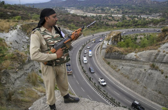 A paramilitary soldier stands guard as the first batch of pilgrims leave for Amarnath Yatra, in Jammu on Wednesday. (PTI Photo)
