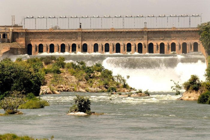 Water gushes from the crest gate of the KRS Dam in Srirangapatna Taluk, Mandya district. (DH file photo)