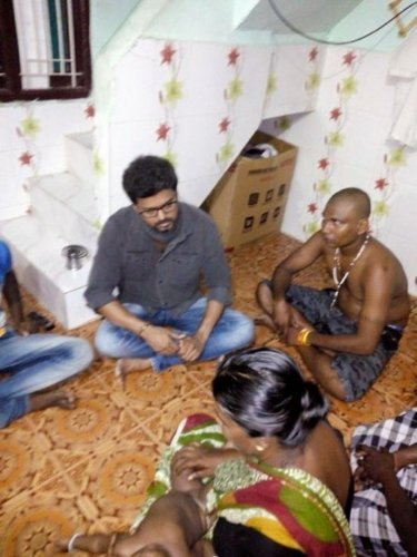 Tamil actor Vijay interacts with Snowlin's family at their residence in Thoothukudi on Tuesday night.