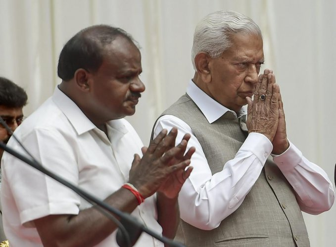 Karnataka Governor Vajubhai Vala and Chief Minister H D Kumaraswamy during the swearing-in ceremony of newly inducted ministers during the first expansion of the JD(S) and Congress coalition government, at Rajbhavan in Bengaluru on Wednesday, June 06, 201