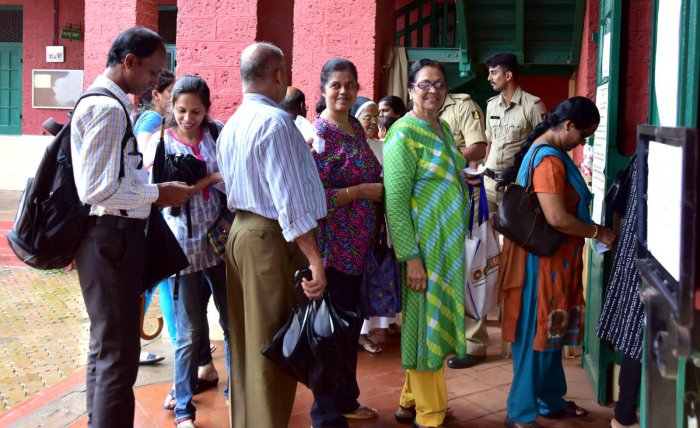 Voters standing in a queue to exercise their franchise, at one of the polling booths, at University College, in Hampankatta on Friday.