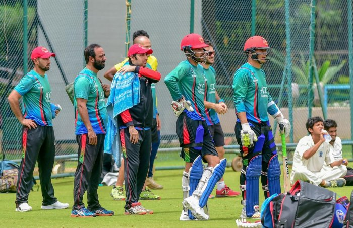 Afghan players during a practice session ahead of the maiden cricket test match between India and Afghanistan, in Bengaluru on Tuesday. (PTI Photo/Shailendra Bhojak)