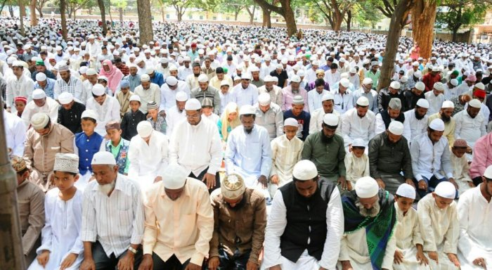 Muslims offer special prayers on the occasion of Eid-ul-Fitr at Eidgah Maidan in Tumakuru on Saturday. DH photo