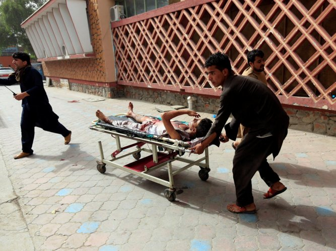 An injured man is pushed on a stretcher to a hospital after a car bomb in Jalalabad city, Afghanistan. (Reuters Photo)