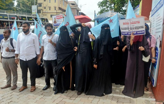 Students, under the aegis of Campus Front of India, stage a protest demanding to allow headscarf inside the classrooms, in front of St Agnes College in Mangaluru on Monday.