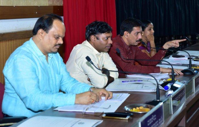 MP Nalin Kumar Kateel speaks at the Development Coordination and Monitoring Committee meeting in Mangaluru on Saturday.