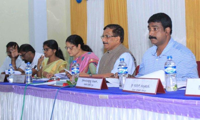 MLA K G Bopaiah chairs quarterly KDP meeting of Madikeri taluk panchayat on Saturday.