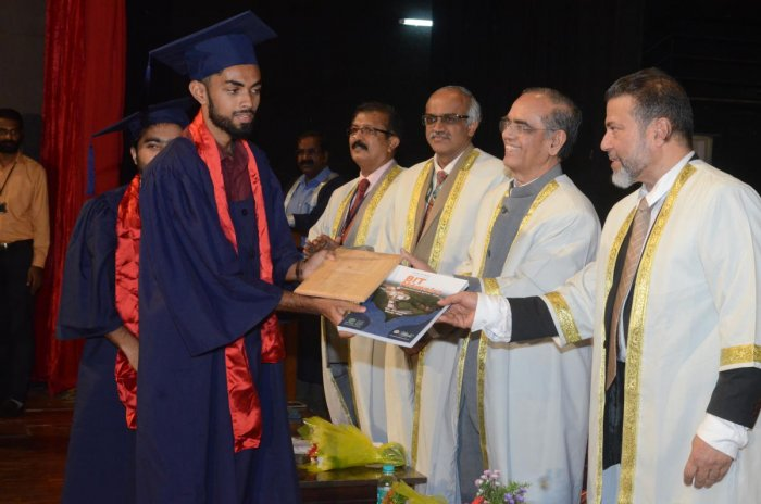 A student receives his degree from Nitte Deemed to be University Pro-Chancellor Dr M Shantaram Shetty during the convocation at Bearys Institute of Technology, Mangaluru.