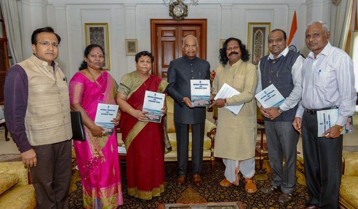 President Ram Nath Kovind receives a special report of the Commission on 'Indira Sagar Polavaram Project Affected Tribal People' from National Commission for Scheduled Tribes Chairperson Dr Nand Kumar Sai at Rashtrapati Bhavan, in New Delhi on Tuesday. PT