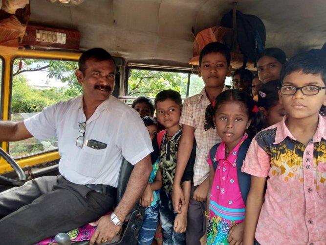 Barali Government School Rajaram with schoolchildren.