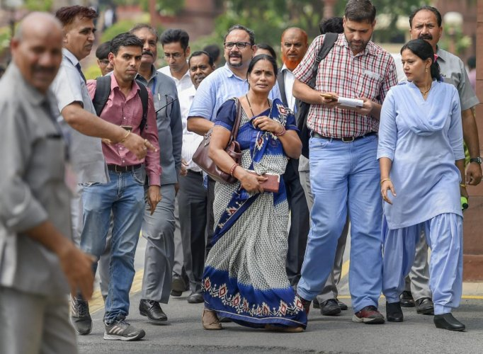Nirbhaya's parents leave the courtroom after Supreme Court's verdict on Dec 2012 gang rape case, in New Delhi on Monday, July 9, 2018. The apex court upheld the death sentence of the three convicts in the case. PTI Photo