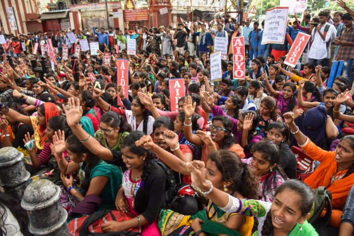 Students are staging protest, against state government, demanding student free bus pass under the banner of AIDSO, AIDYO and AIMSS, at Mysore Bank Circle in Bengaluru on Wednesday. Photo by S K Dinesh
