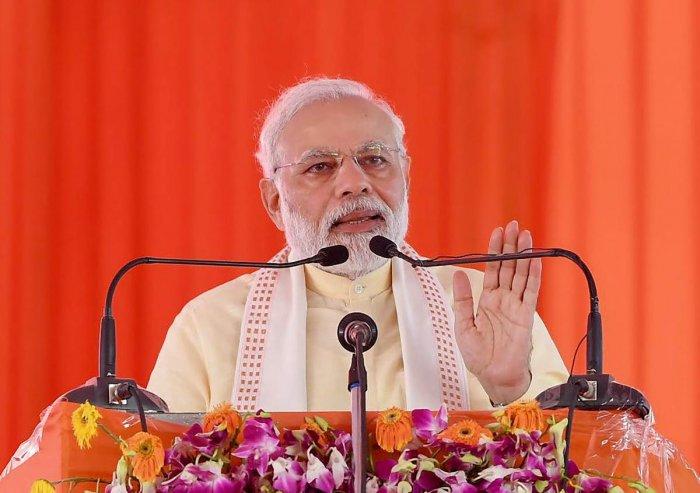 Prime Minister, Narendra Modi addressing at the foundation stone laying ceremony of Poorvanchal Expressway, in Azamgarh, Uttar Pradesh on Saturday. PTI