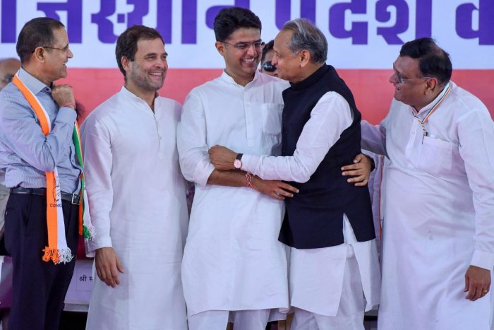 Congress president Rahul Gandhi with AICC general secretary Ashok Gehlot and RPCC President Sachin Pilot during a party meeting at Ramlila Maidan in Jaipur on Saturday. PTI