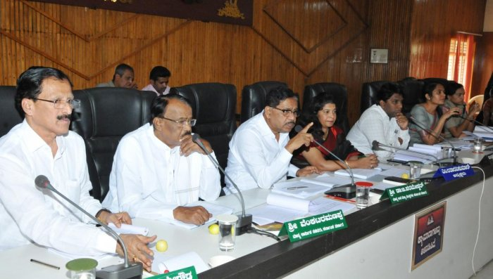 Deputy chief minister and district in-charge minister G Parameshwara warned of action against deputy commissioner Dr K Rakesh Kumar and Zilla Panchayat Chief Executive Officer (CEO) Annies Kanmani Joy of disciplinary action if they failed to take action against inactive subordinates who have failed to implement government projects.
