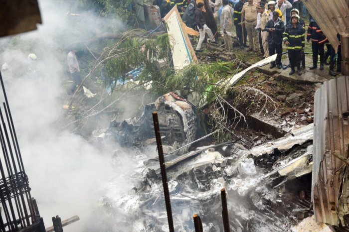 Firefighters try to douse the flames of the King Air C-90 plane that crashed in Mumbai. PTI photo.