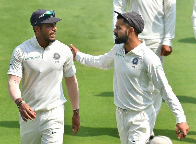 India's Virat Kohli (right) and Umesh Yadav