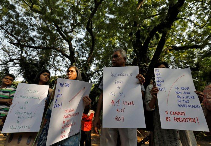 Journalists hold placards during a protest against what they say is sexual harassment in the workplace in New Delhi on Saturday. REUTERS
