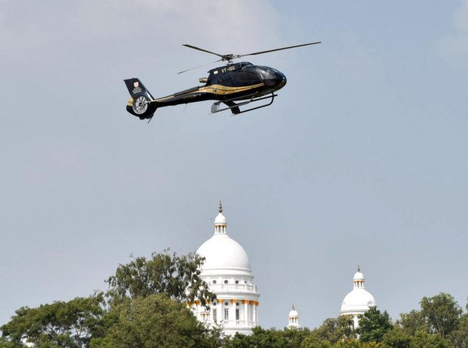 A helicopter hovers over the Lalitha Mahal Palace in Mysuru on Saturday.