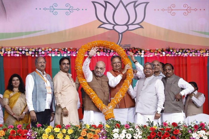 BJP National President Amit Shah being garlanded along with Chhattisgarh Chief Minister Raman Singh during a party workers' meeting in Raipur, Chhattisgarh, on Friday. PTI