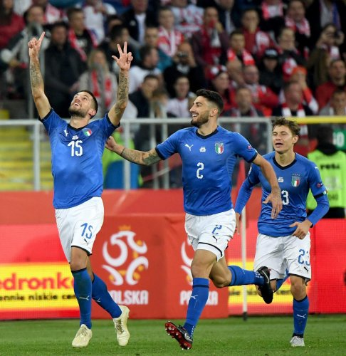 Italy's Cristiano Biraghi (left) celebrates with his team-mates after scoring against Poland on Sunday. AFP