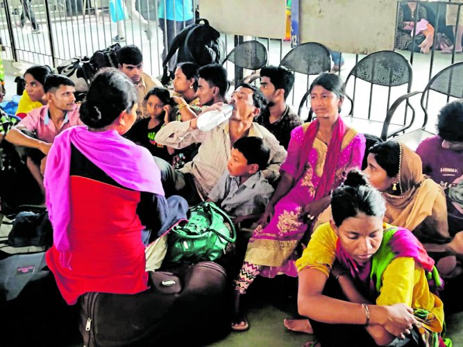 The detained Bangladeshis in Guwahati railway station on Monday. Photo by Manash Das