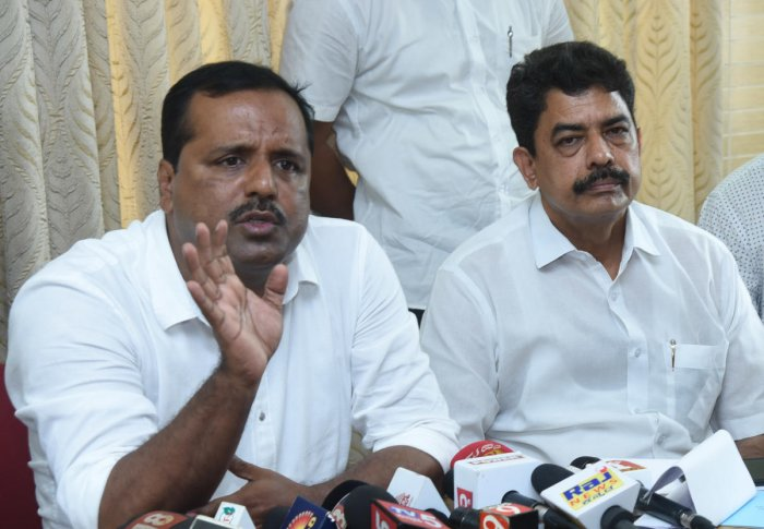 Urban Development and Housing Minister U T Khader addresses a press meet in Mangaluru on Tuesday.