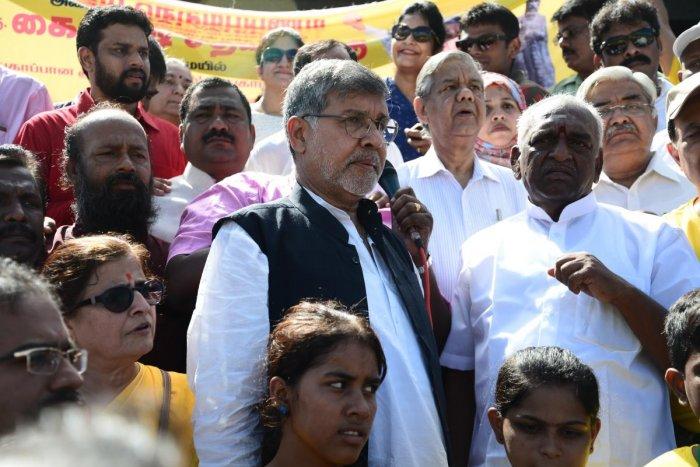 Pon Radhakrishnan (Right)