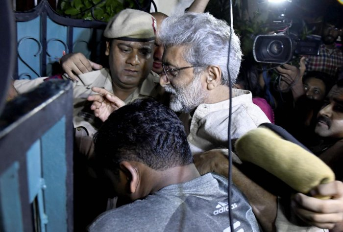 Human rights activist Gautam Navlakha at his residence after he was arrested by the Pune police in connection with the Bhima Koregaon violence, in New Delhi. PTI