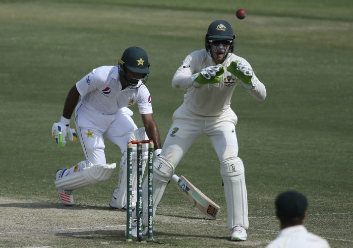 Abu Dhabi: Australia's Tim Paine, right, tries to catch the ball as Pakistan's Asad Shafiq saves the wicket during their cricket test match in Abu Dhabi, United Arab Emirates, Thursday, Oct. 18, 2018. AP/PTI(AP10_18_2018_000038B)