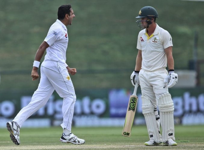 WRECKER IN CHIEF Pakistan's Mohammad Abbas (left) celebrates the dismissal of Australia's Travis Head in the second Test on Friday. AP/PTI