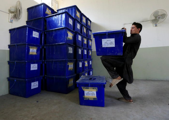 An Afghan election commission worker prepares ballot boxes and election material to send to the polling stations at a warehouse in Jalalabad, Afghanistan October 19, 2018. (Reuters Photo)