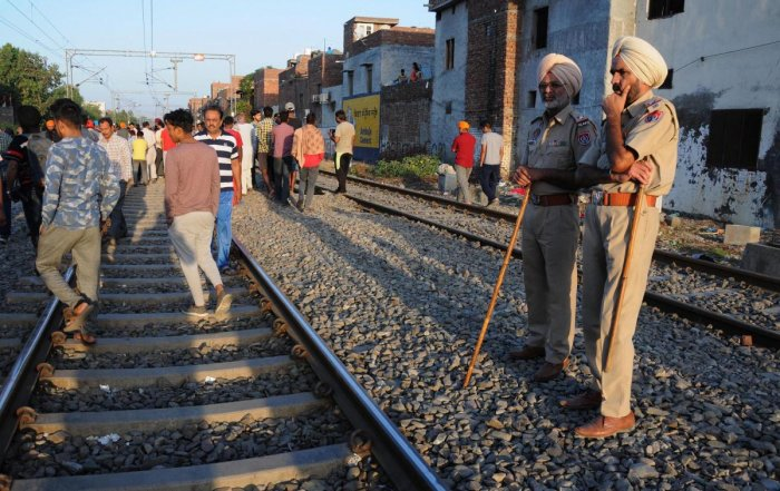 Punjab Police personnel at the scene of the accident along railroad tracks in Amritsar. PTI photo